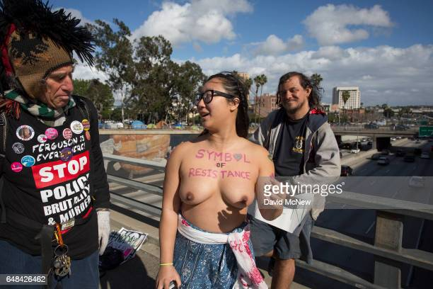 Anni Ma passes over the 101 freeway as she marches topless for the right of women to decide for themselves what they do with their bodies during the...