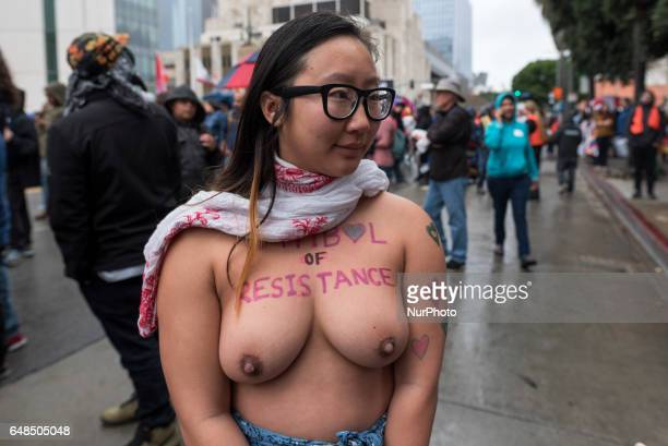Image contains nudity Anni Ma passes over the 101 freeway as she marches topless for the right of women to decide for themselves what they do with...