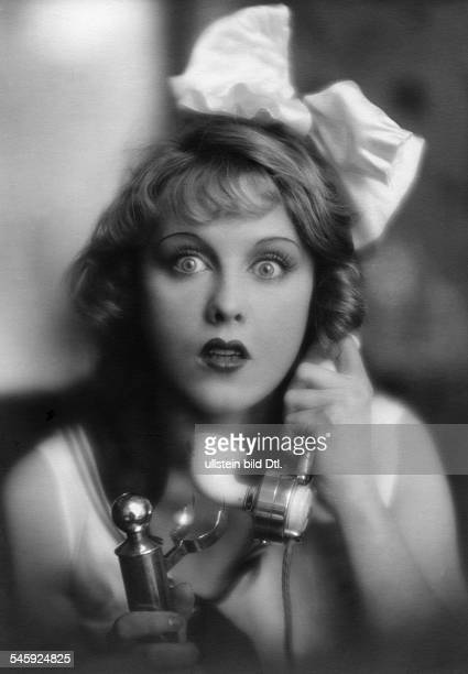 Anni Ondra Schmeling*actress Germanyon the phone date unknown probably arround 1926photo by Atelier Martin Badekow