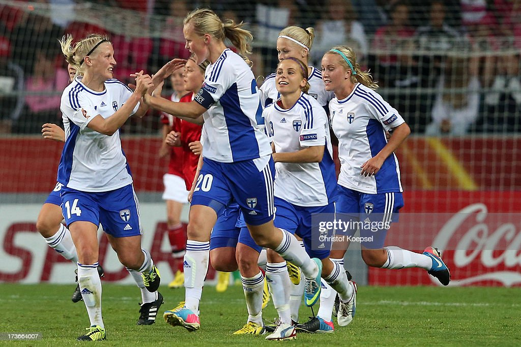 Annica Sjoelund of Finland (2nd L) celebrates the first goal with Sanna Talonen of Finland (L) during the UEFA Women's EURO 2013 Group A match between Denmark and Finland at Gamla Ullevi Stadium on July 16, 2013 in Gothenburg, Sweden.