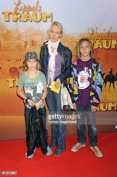 Annick Wecker with her kids Valentin and Tamino attend the premiere 'Lippels Traum' at the MaxxX Filmpalast on October 3 2009 in Munich Germany