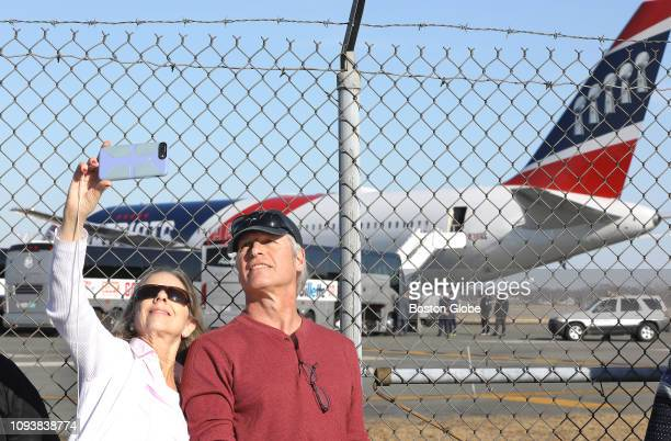 Annie and Rick Jones of Newport RI take a selfie with the Patriots plane after the team arrived at TF Green Airport in Warwick RI from Atlanta...