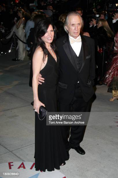 Annie Bierman and David Carradine during 2005 Vanity Fair Oscar Party Arrivals at Mortons in Los Angeles California United States