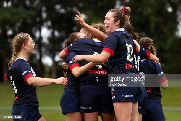Annie Buntine of the Rebels and team mates celebrate during the Super W match between the Melbourne Rebels and the ACT Brumbies at Coffs Harbour...