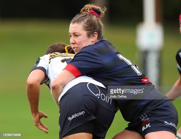 Annie Buntine of the Rebels tackles during the Super W match between the Melbourne Rebels and the ACT Brumbies at Coffs Harbour International Stadium...