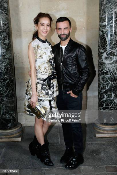 Annie Chen and stylist Nicolas Ghesquiere pose after the Louis Vuitton show as part of the Paris Fashion Week Womenswear Spring/Summer 2018 on...