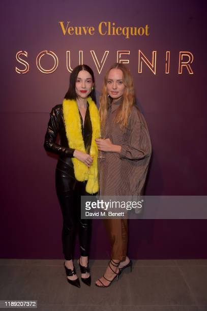 Annie Clark aka St Vincent and Laura Haddock attend the launch of Veuve Clicquot Souvenir bar hosted and directed by St Vincent in Covent Garden on...