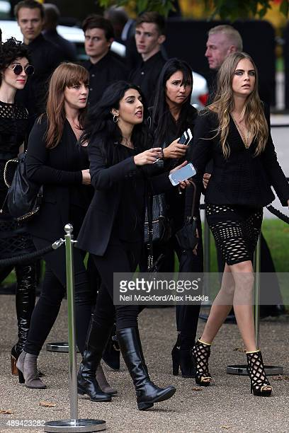 Annie Clark and Cara Delevinge attend the Burberry Prorsum s/s16 catwalk show on September 21 2015 in London England Photo by Neil Mockford/Alex...
