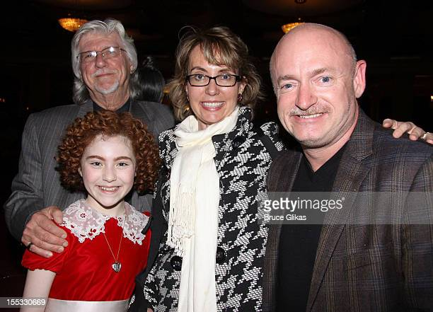 "Annie composer Martin Charnin, Lilla Crawford as ""Annie"", Gabrielle Giffords and husband Mark E. Kelly pose backstage at the hit revival of ""Annie""..."