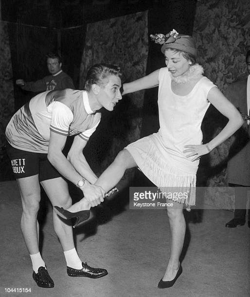Annie CORDY raising her leg held by the cyclist Jacques ANQUETIL during the NUIT DU SPORT a gala organized to benefit the national association of...