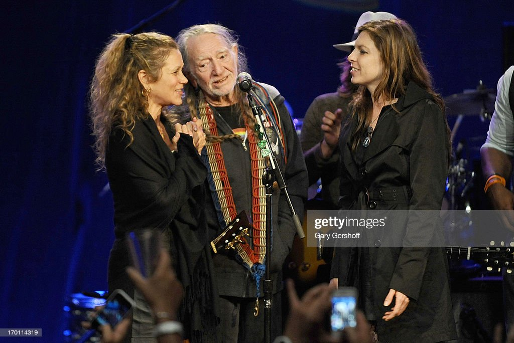 Annie D'Angelo, Willie Nelson and Amy Nelson perform on stage at the Hard Rock International's Wille Nelson Artist Spotlight Benefit Concer at Hard Rock Cafe, Times Square on June 6, 2013 in New York City.