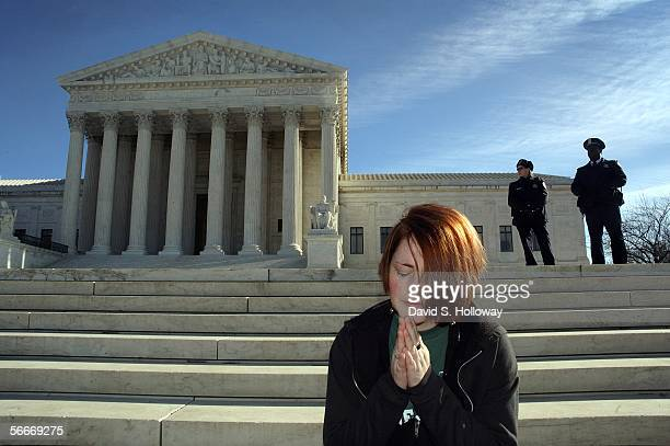 Annie Daniele of Fredricksburg VA prays during a March for Life prayer vigil in front of the Supreme court building on January 22 2006 in Washington...