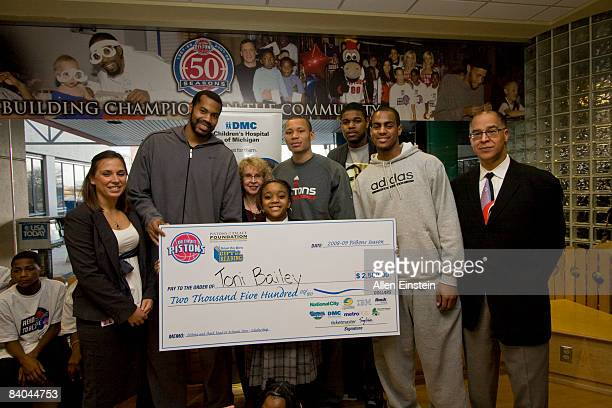 Annie Dunsky of IBM Rasheed Wallace of the Detroit Pistons Sharon Martin of the Detroit Newspapers Detroit Pistons Alex Acker Amir Johnson and Arron...