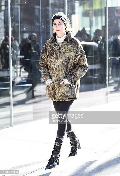 Annie Georgia Greenberg is seen outside the Tibi show wearing a Mossy Oak hunting print jacket and REI boots during New York Fashion Week Women's...