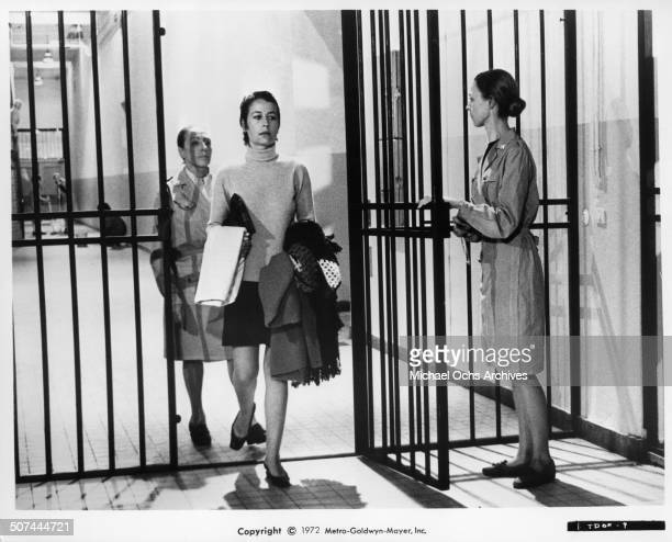 Annie Girardot is lead into prison after being condemned by public and courts for her liaison with a student in a scene from the MGM movie 'To Die of...