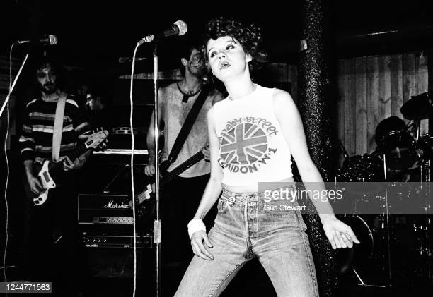 Annie Golden, wearing a Carnaby Street t-shirt, with Ronnie Ardito and Robert Racioppo behind of US punk band The Shirts performs on stage at...