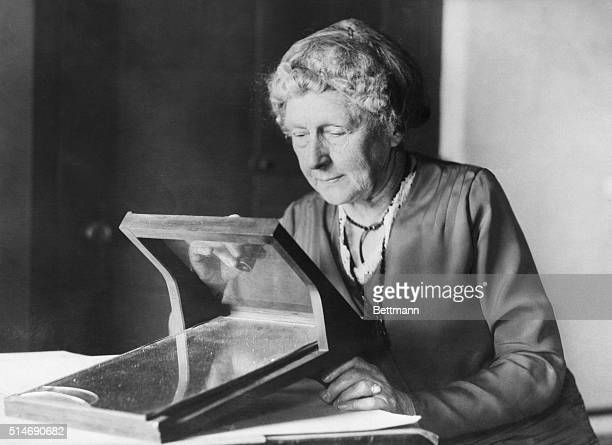 Annie J Cannon curator of photographs at the Harvard College Observatory is charged with the care of 300000 photographic plates of stars made by...