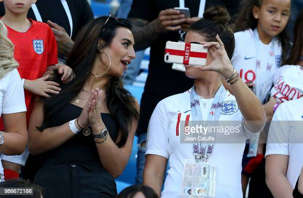 Annie Kilner, girlfriend of Kyle Walker of England, Rebekah Vardy, wife of Jamie Vardy during the 2018 FIFA World Cup Russia group G match between...