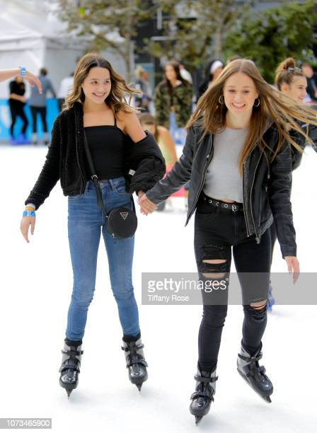 Annie LeBlanc and Riley Lewis attend Instagram's #Instaskate 2018 at LA Kings Holiday Ice LA Live on November 27 2018 in Los Angeles California
