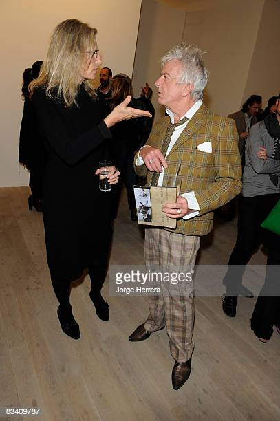 Annie Leibovitz and Nicky Haslam talk at a reception for an exhibtion of Leibovitz's work at Phillips de Pury on October 23 2008 in London England