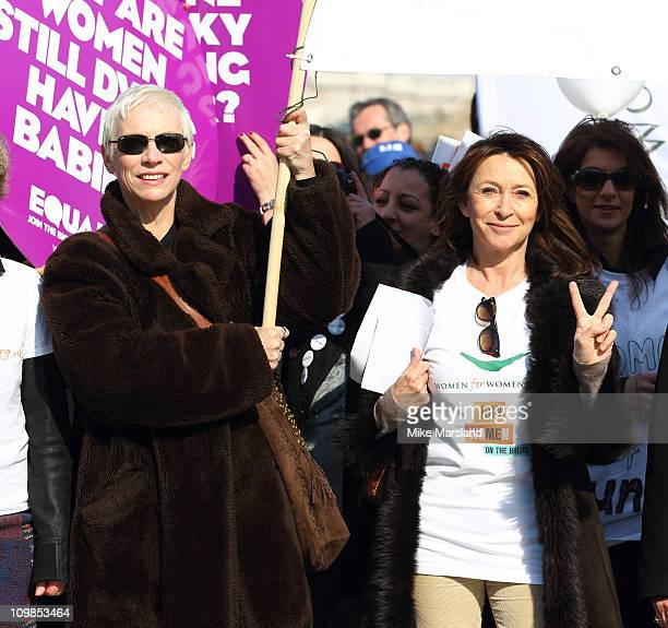 Annie Lennox and Cherie Lunghi join together to lead a march in aid of International Women's Day at Millennium Bridge on March 8 2011 in London...