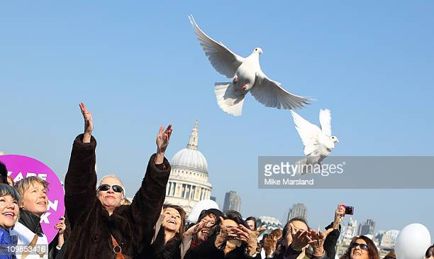 Annie Lennox and Cherie Lunghi joins together to lead a march in aid of International Women's Day at Millennium Bridge on March 8 2011 in London...