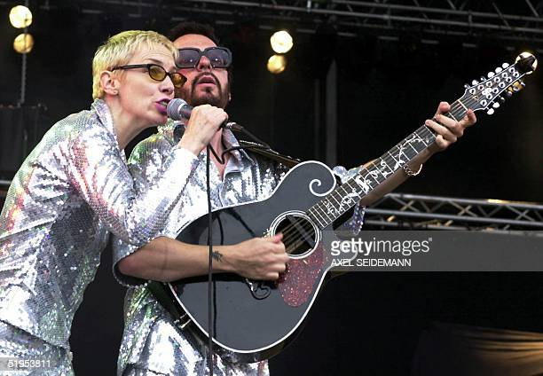 Annie Lennox and Dave Stewart of the pop duo Eurythmics sing on stage at Nuremburg racing circuit during the openair rock festival 10 June 2000 Some...