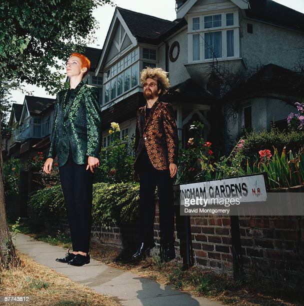 Annie Lennox and David A Stewart of British synth pop duo Eurythmics appearing to levitate on a suburban street London circa 1985