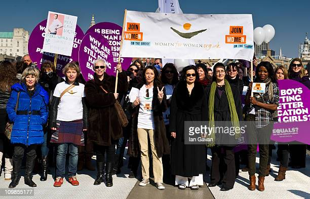 Annie Lennox Cheri Lunghi Bianca Jagger and x attends photocall ahead of a march in aid of International Women's Day at the Millenium Bridge on March...