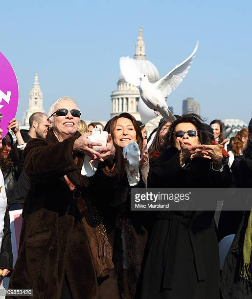 Annie Lennox Cherie Lunghi and Bianca Jagger join together to lead a march in aid of International Women's Day at Millennium Bridge on March 8 2011...
