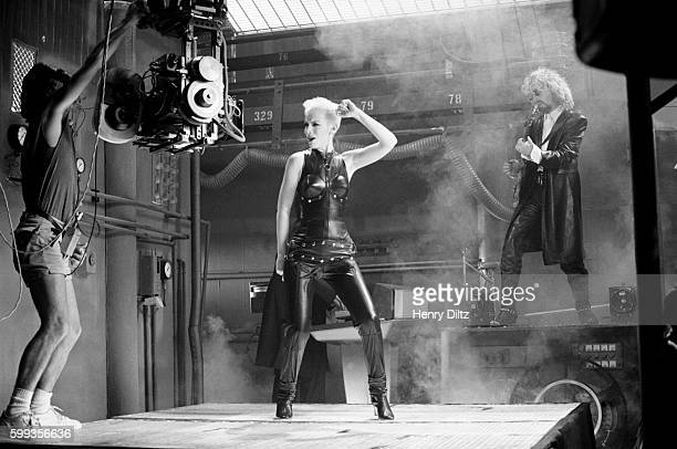 Annie Lennox dances and Dave Stewart plays guitar for the Eurythmics video 'Missionary Man'