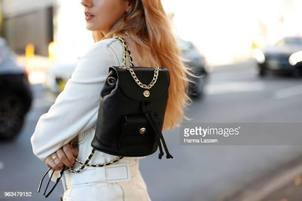 Annie Lewis bag detail wearing Paris Georgia suit Dylan Kain backpack George Keburia sunglasses and Golden Goose sneakers on May 29 2018 in Sydney...