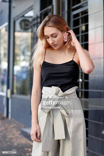Annie Lewis wearing Michael Lo Sordo cami top Petar Petrov pants and Sophia Webster shoes on May 29 2018 in Sydney Australia