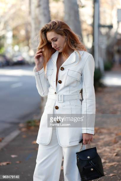 Annie Lewis wearing Paris Georgia suit Dylan Kain backpack George Keburia sunglasses and Golden Goose sneakers on May 29 2018 in Sydney Australia