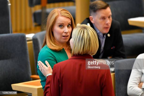 Annie Loof leader of Sweden's Center Party left speaks with Ebba Busch Thor leader of the Christian Democrats during a session in Parliament in...