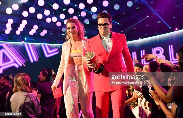 Annie Murphy and Daniel Levy attend the 2019 MTV Movie and TV Awards at Barker Hangar on June 15 2019 in Santa Monica California