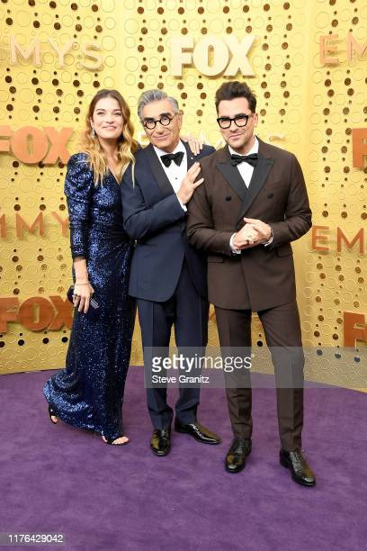 Annie Murphy Eugene Levy and Daniel Levy attend the 71st Emmy Awards at Microsoft Theater on September 22 2019 in Los Angeles California