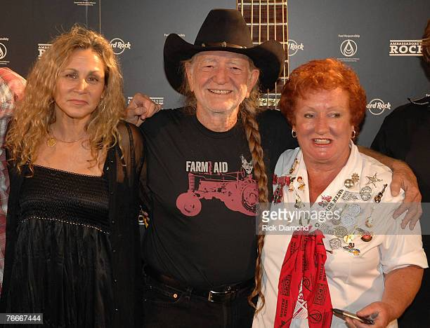Annie Nelson cofounder of Sustainable Biodiesel Alliance Musician Willie Nelson and Rita Gilligan Hard Rock Ambassador arrive on The Green Carprt...