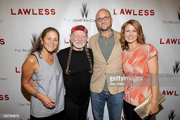 Annie Nelson musician Willie Nelson author Matt Bondurant and Stacy Bondurant on the red carpet for the new film Lawless at the Alamo Drafthouse on...
