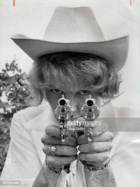 Annie Oakley got her guns at party yesterday Girl behind guns Elaine Strich still has to practise her sharpshooting style