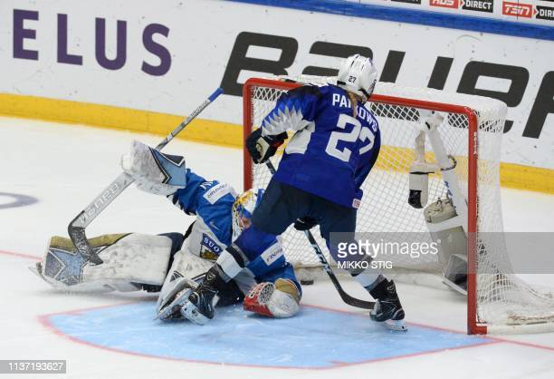 Annie Pankowski of the United States scores a shootout goal past goalkeeper Noora Räty of Finland during the IIHF Women's Ice Hockey World...