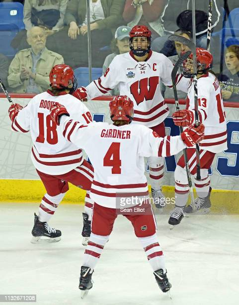 Annie Pankowski of the Wisconsin Badgers back center is congratulated by teammates Abby Roque Mikeala Gardner and Maddie Rolfes after scoring the...
