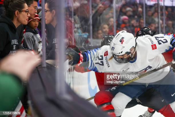 Annie Pankowski of U.S. Women's Hockey Team fights for control of the puck against the Canadian Women's National Team at Honda Center on February 08,...