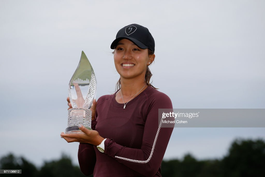 Annie Park holds the trophy after winning the ShopRite LPGA Classic Presented by Acer on the Bay Course at Stockton Seaview Hotel and Golf Club on June 10, 2018 in Galloway, New Jersey.