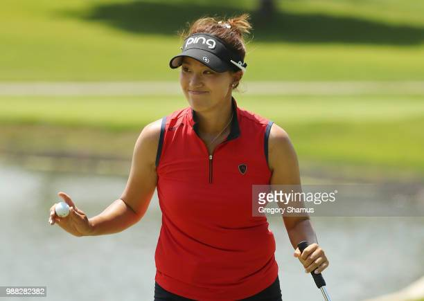 Annie Park waves to fans after a birdie on the third green during the final round of the 2018 KPMG PGA Championship at Kemper Lakes Golf Club on June...