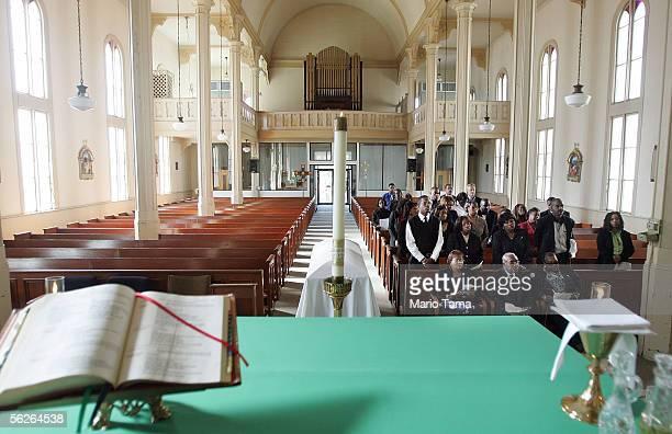 Annie Richburg attends the funeral for her husband Hurricane Katrina drowning victim Lejohn Richburg Jr at St Francis DeSales Catholic Church...