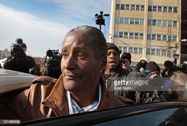 Annie Ricks is followed by journalists as she climbs into a car to leave the CabriniGreen public housing complex for the last time after being forced...