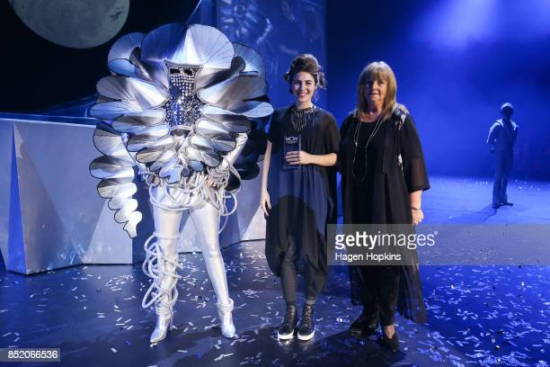Annie Temmink of the United States poses with her creation 'Daisy' and WOW competition director Heather Palmer after winning the First Time Entrant...