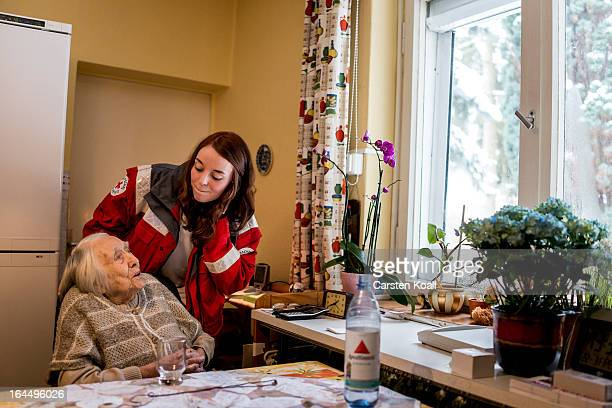 Annie Therre who works for the German Red Cross makes a visit to 100yearold senior citizen Frida Fiedler in order to illustrate the emergency...
