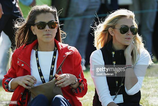 Annie Verret and Paulina Gretzky watch the play of the United States Team on the ninth hole during the Friday fourball matches at The Presidents Cup...